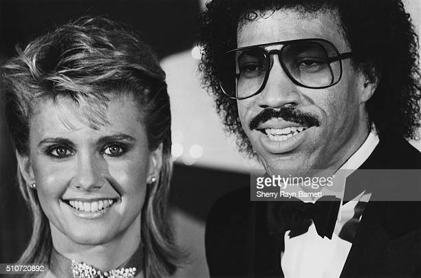 R and B singer and actress and singer Olivia NewtonJohn attend the 26th Annual Grammy Awards at The Shrine Auditorium on February 28 1984 in...