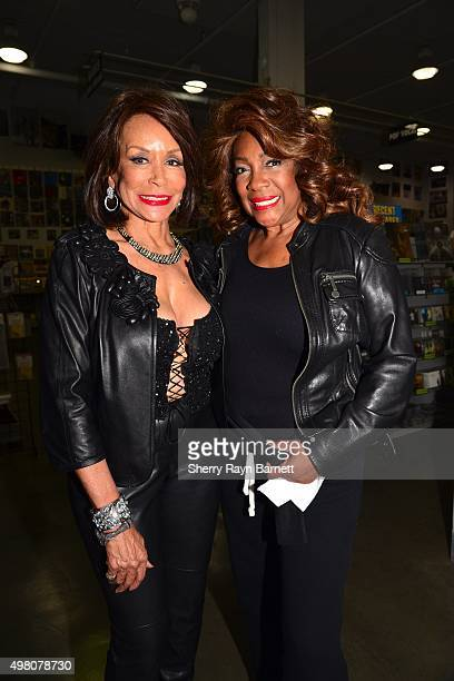 R and B singers Freda Payne and Mary Wilson pose for a photo at Amoeba Records on November 18 2015 in Los Angeles California