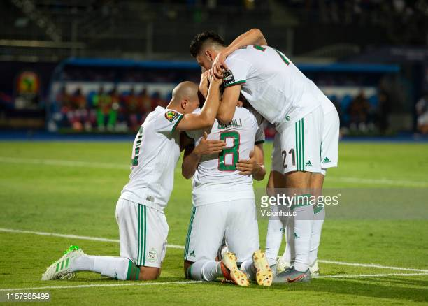BENSEBAINI and BAGHDAD BOUNEDJAH celebrates Algeria's first goal during the 2019 Africa Cup of Nations Group C match between Algeria and Kenya at...