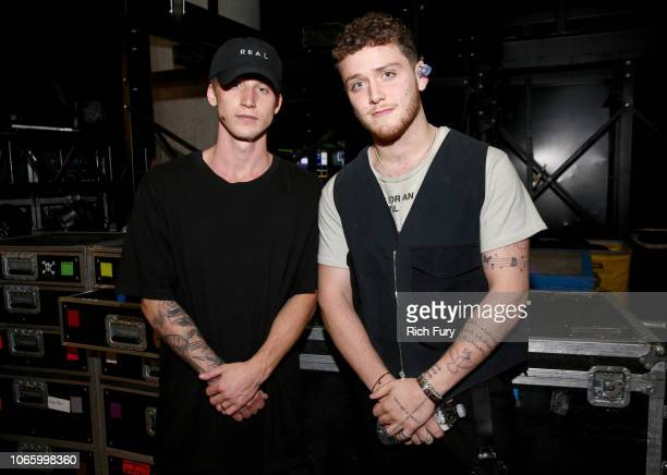 NF and Bazzi attend 1061 KISS FM's Jingle Ball 2018 at American Airlines Center on November 27 2018 in Dallas Texas