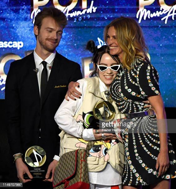 FINNEAS and Billie Eilish accept the Vanguard Award from Julia Roberts onstage during the 36th annual ASCAP Pop Music Awards at The Beverly Hilton...