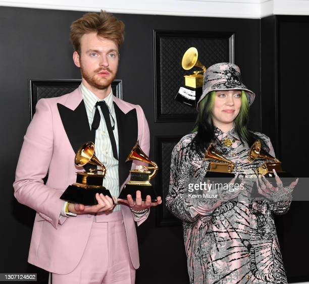 """And Billie Eilish, winners of Record of the Year for 'Everything I Wanted' and Best Song Written For Visual Media for """"No Time To Die"""", pose in the..."""