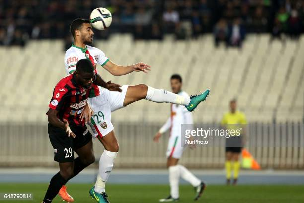 and BOUHENNA RACHID fight for the ball during the Algerian derby mache MC Algiers Against USM Alger at the Stage 5 July Algiers on
