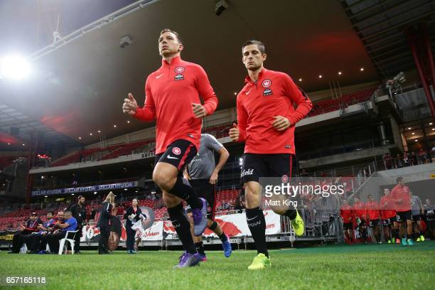 and Brendon Santalab and Shannon Cole of the Wanderers enter the field of play for warm up during the round 24 ALeague match between the Western...
