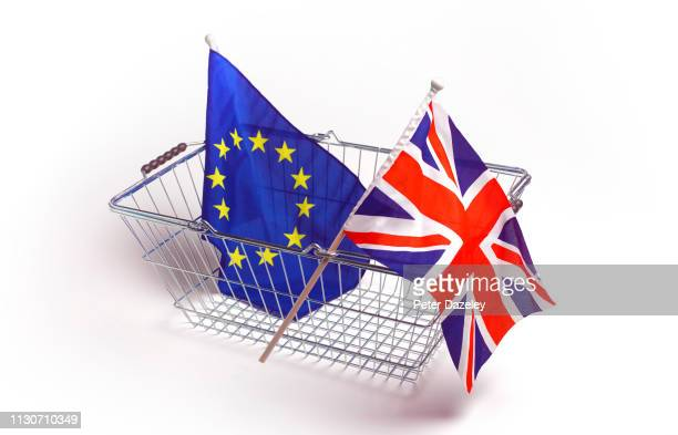 eu and british flag in supermarket shopping basket - agreement stock pictures, royalty-free photos & images