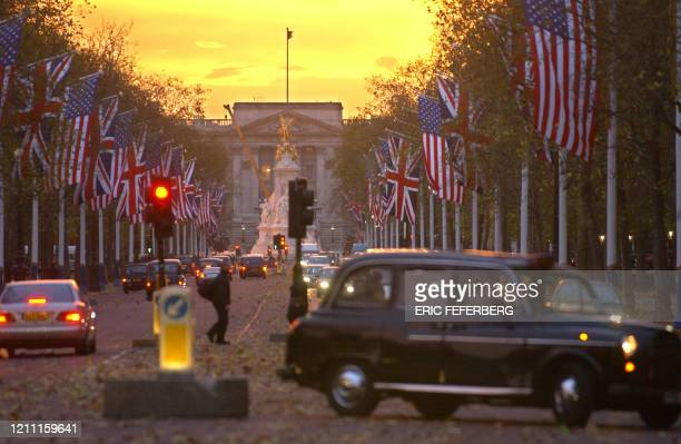 And British flags fly in Pall Mall in front of Buckingham Palace 14 November 2003 in London, few days before US President George W. Bush state visit...