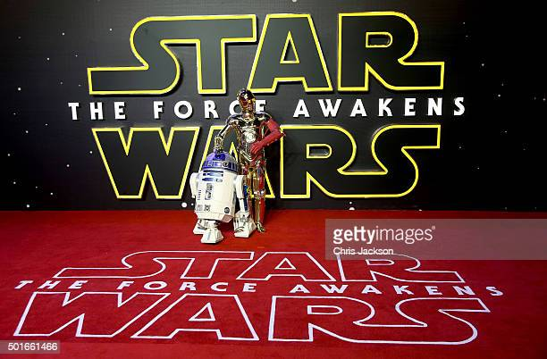 D2 and C3PO attend the European Premiere of 'Star Wars The Force Awakens' at Leicester Square on December 16 2015 in London England