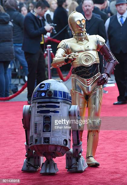 and C3PO characters arrive at the premiere of Walt Disney Pictures and Lucasfilm's 'Star Wars The Force Awakens' at the Dolby Theatre on on December...