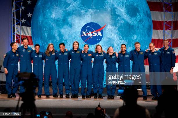 NASA and Canadian Space Agency astronauts acknowledge the audience after their graduation ceremony at Johnson Space Center in Houston Texas on...