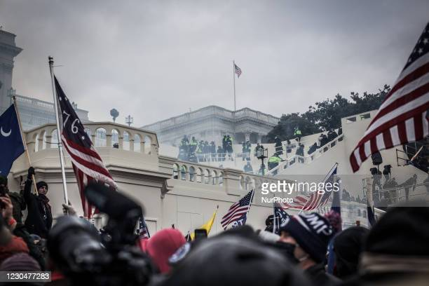 And capitol police pull back Trump supporters near the U.S. Capitol on January 06, 2021 in Washington, DC. The protesters stormed the historic...