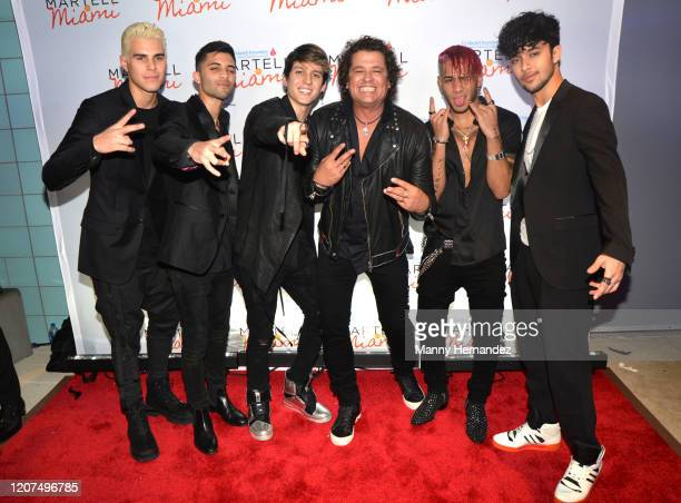 CNCO and Carlos Vives at the TJ Martell Foundation's 2020 Martell In Miami Gala at the Frost Science Museum on February 19 2020 in Miami FL