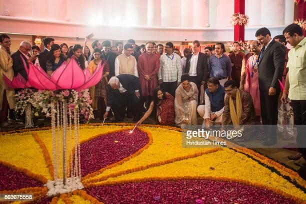 MD and CEO Ashishkumar Chauhan along with Bollywood actress Richa Chadda burns candle during Muhurat trading during Lakshmi Pujan on the occasion of...