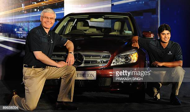 MD and CEO of MercedesBenz India Wilfried G Aulbur poses with newly launched Mercedes Benz's 'Special Edition Cclass' and Indian Golfer Gaganjeet...