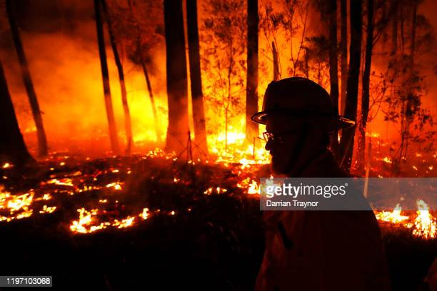and CFA Crews monitor fires and begin back burns between the towns of Orbost and Lakes Entrance in east Gipplsland on January 02 2020 in Australia...