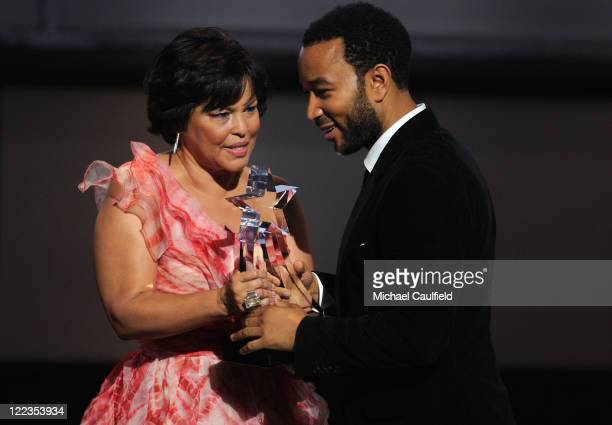 And Chairman Debra Lee and musician John Legend speak onstage during the 2010 BET Awards held at the Shrine Auditorium on June 27, 2010 in Los...