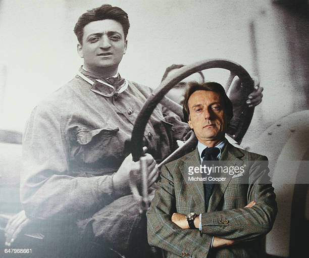 CEO and Chairman of Ferrari Luca Di Montezemolo stands in front of a picture of Scuderia Ferrari founder Enzo Ferrari on 1 May 1999 at the Scuderia...