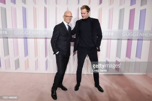 CEO and Chairman of HUGO BOSS AG Mark Langer and actor Alexander Skarsgard attend as Hugo Boss Prize 2018 Artists Dinner at the Guggenheim Museum on...