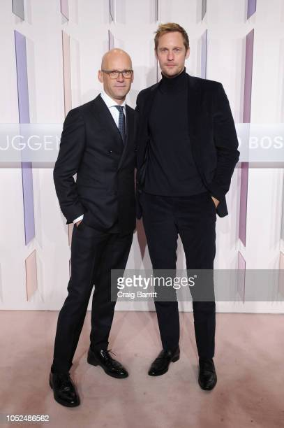 CEO and Chairman of HUGO BOSS AG Mark Langer and actor Alexander Skarsgard attend the Hugo Boss Prize 2018 Artists Dinner at the Guggenheim Museum on...