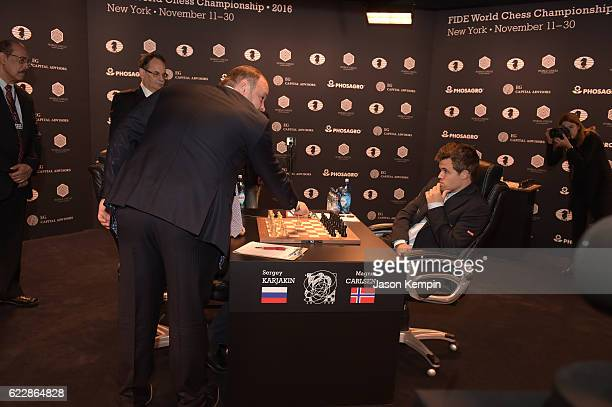 CEO and Chairman of the Management Board PHOSAGRO Andrey A Guryev makes the first move for the game between Reigning Chess Champion Magnus Carlsen...