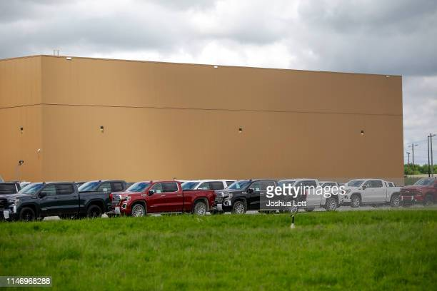 And Chevrolet pickup trucks sit in a parking lot outside the GM Fort Wayne Assembly Plant on May 30, 2019 in Roanoke, Indiana. General Motors...