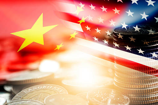 USA and China flag on coins stacking .It is symbol of economic tariffs trade war and tax barrier between United States of America and China. 1177244507