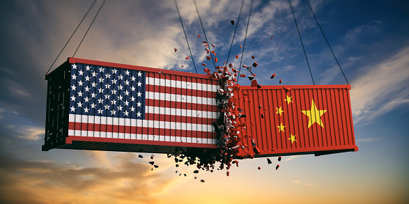 USA and China trade war. US of America and chinese flags crashed containers on sky at sunset background. 3d illustration 1056780444