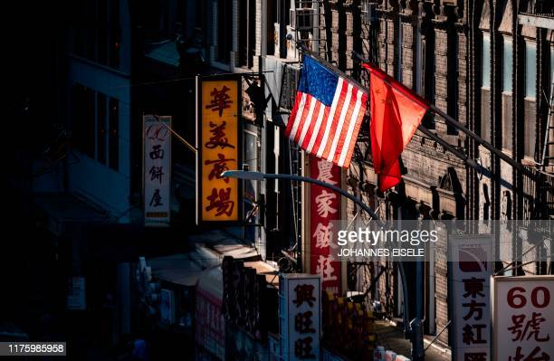 And Chinese flag are seen in Chinatown on October 14, 2019 in New York City.