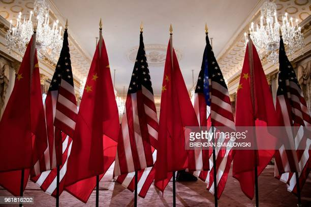 US and Chinese flags are seen as Secretary of State Mike Pompeo and China's Foreign Minister Wang Yi meet at the US Department of State May 23 2018...