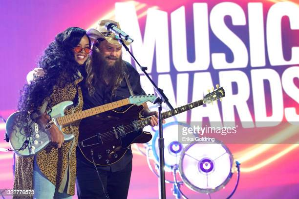 And Chris Stapleton perform onstage for the 2021 CMT Music Awards at Bridgestone Arena on June 09, 2021 in Nashville, Tennessee.
