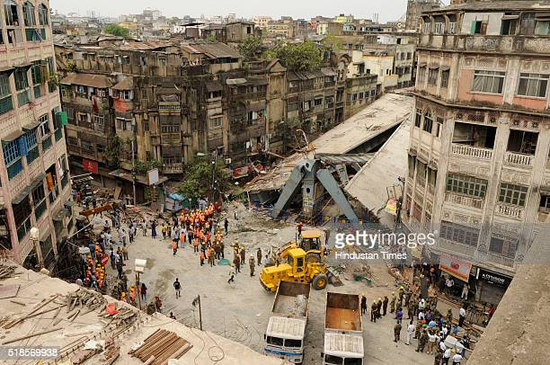 NDRF and Civil Defence Rescue teams clearing the debris of an under construction flyover collapsed on Vivekananda road on April 1 2016 in Kolkata...
