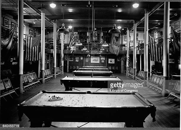 US and college flags decorate the students' pool hall at Holy Cross college in Worcester Massachusetts