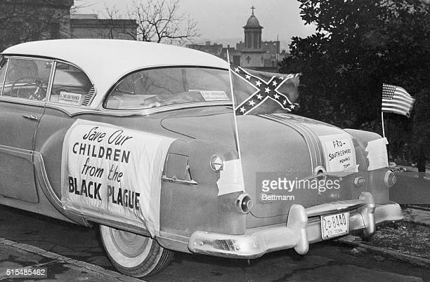 US and Confederate flags fly from a car parked on Tennessee's Capitol HIll in Nashville as Governor Frank Clement met with a delegation of...