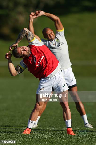 and Cornal Hendricks stretch during a South Africa Springboks training session at Porirua Park on September 9 2014 in Wellington New Zealand