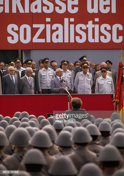 USSR and DDR leaders Leonid Brezhnev and Erich Honecker watch a military parade organized in East Berlin to celebrate the Berlin wall's anniversary