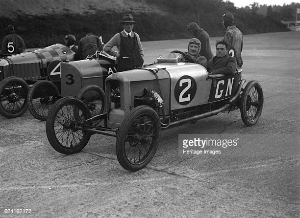 GN AV and Deemster racing cars at the JCC 200 Mile Race Brooklands Surrey 1921 Artist Bill BrunellRight GN 1086 cc Entry No 2 Driver Frazer Nash A...