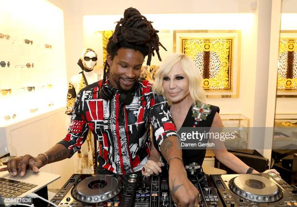 CRACKSTEVENS and Donatella Versace attend the Versace Boutique Opening on Sloane Street on December 5 2017 in London England