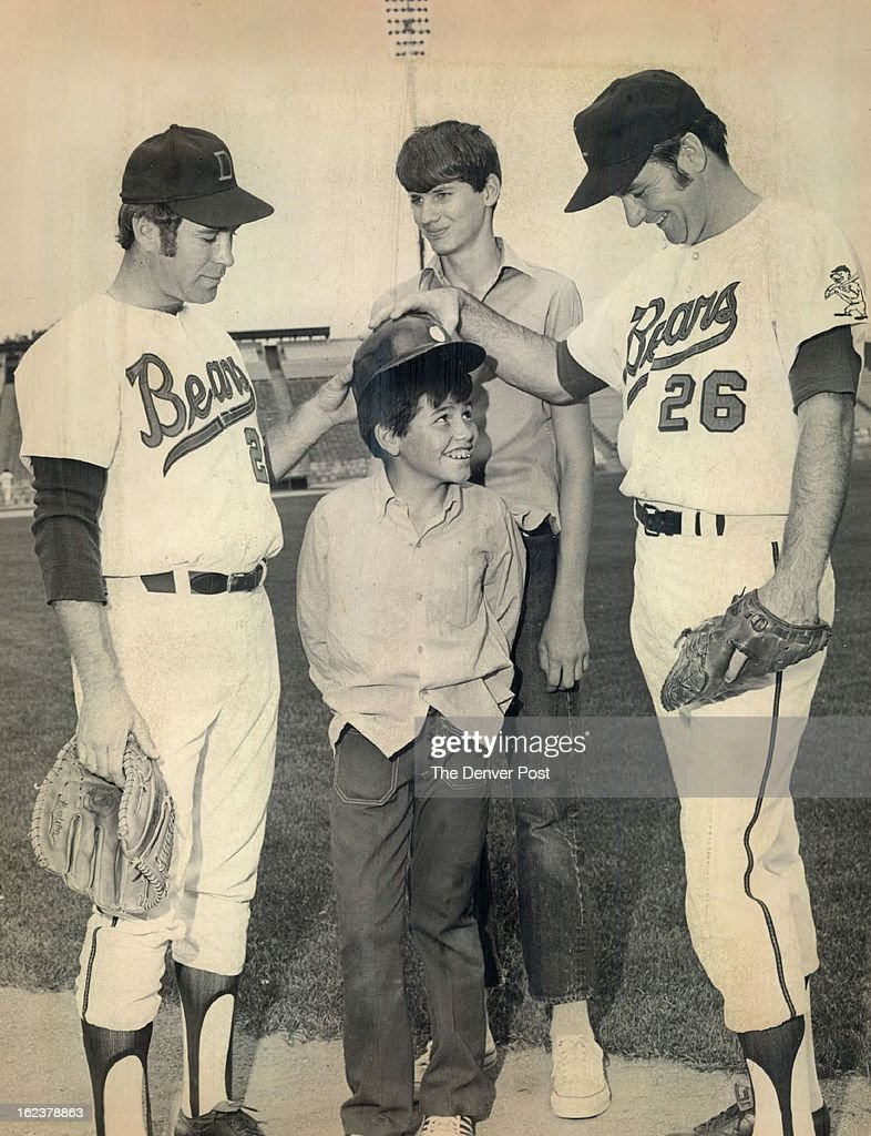 AUG 25 1971; ....And Don't Forget to Wear this at the Plate; Denver pitcher Garland shifflett, left, : News Photo
