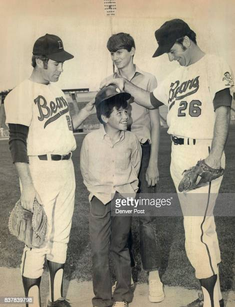AUG 25 1971 And Don't Forget to Wear this at the Plate Denver pitcher Garland shifflett left named the American Association Pitcher of the year...