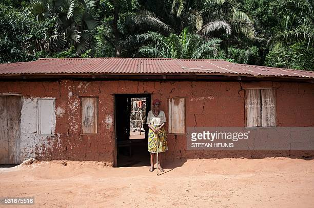 And elderly woman stands outside her house on May 5 2016 in Nimbo southeastern Nigeria where nomadic Fulani herdsman attacked the village Ongoing...