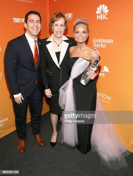CEO and Executive Director at The Trevor Project Amit Paley Carol Burnett and honoree Kristin Chenoweth pose with the Icon Award during The Trevor...