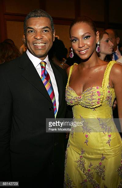 VP and Executive Director VH1 Save The Music Paul Cothran and Beyonce Knowles pose for a photo at the Beyonce Beyond the Red Carpet auction presented...