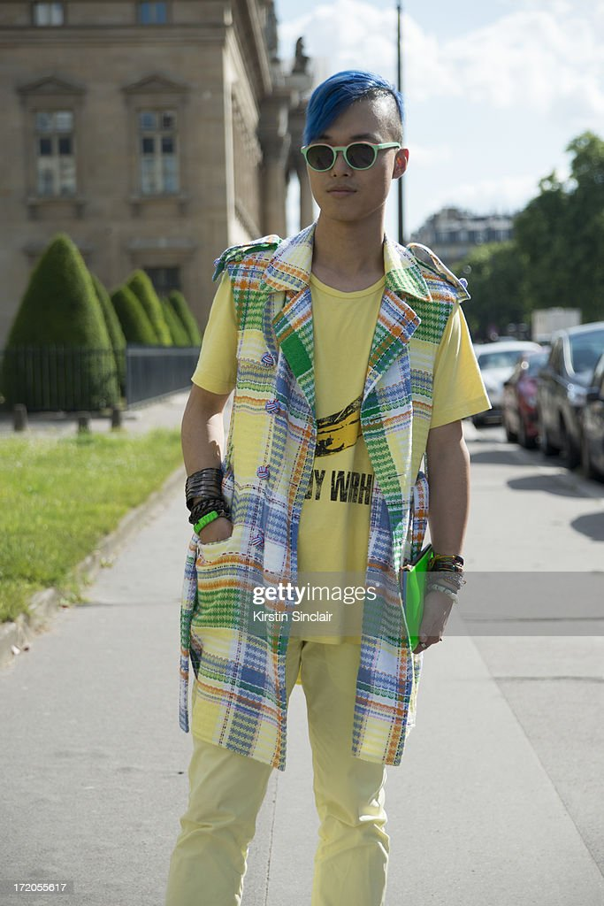 DJ, MC and Fashion blogger Peter Xu wearsThom Browne jacket, Etma sunglasses, JKJY trousers, Uniqlo t-shirt, Commes des Garcons clutch bag on day 5 of Paris Collections: Men on June 30, 2013 in Paris, France.