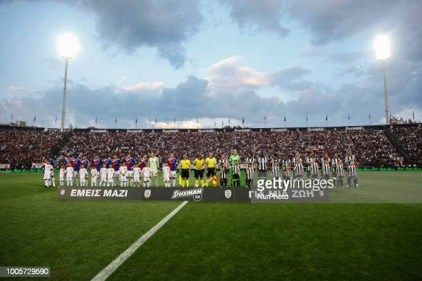 PAOK and FC Basel teams line up before the Champions League second qualifying round first leg football match between PAOK FC and FC Basel at the...