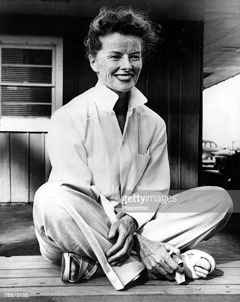TV and Films 1950s Stratford Conneticut USA Legendary US film actress Katherine Hepburn is pictured crosslegged on her verandah