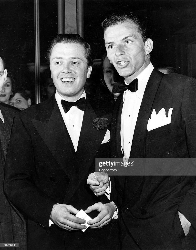T.V. and Films. 7th July 1950. London, England. Legendary US film star, singer and entertainer Frank Sinatra is pictured with British actor and Director Richard Attenborough (L) at the Cambridge Theatre, for the first night of -The Ace of Clubs+. : News Photo