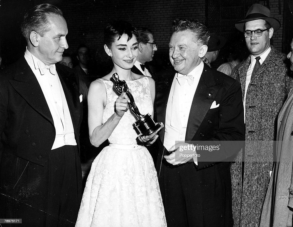 """T.V. and Films. 1953. A picture of legendary Belgian born American actress Audrey Hepburn with Frederic March and a Best Actress -Oscar+ for her role in """"Roman Holiday"""". : News Photo"""