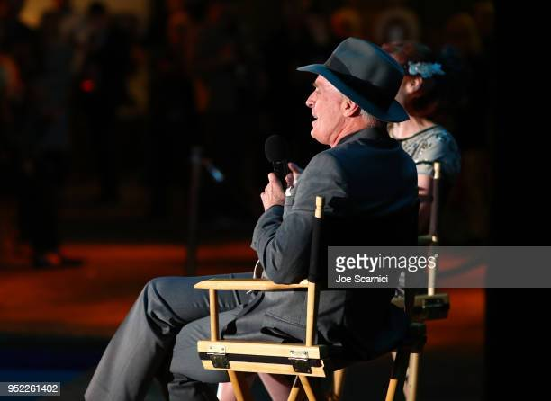 TCM and Filmstruck Host Alicia Malone and actor Keith Carradine speak onstage at the screening of 'The Roaring Twenties' during Day 2 of the 2018 TCM...