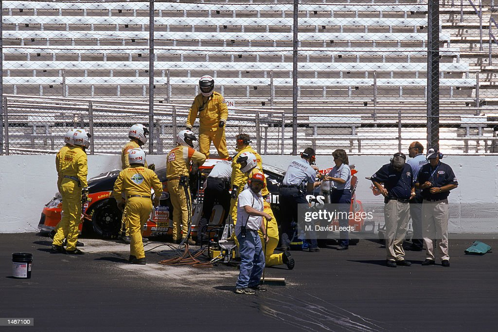 E.M.T. attend to Adam Petty and his car : News Photo