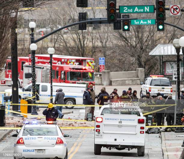 And first responders work on the scene after an explosion on December 25, 2020 in Nashville, Tennessee. According to initial reports three people...