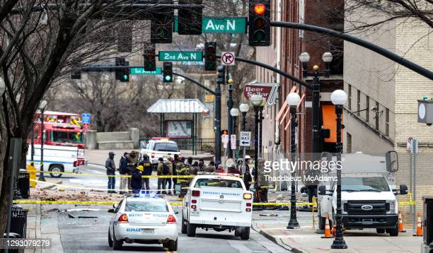 And first responders work on the scene after an explosion on December 25, 2020 in Nashville, Tennessee. According to initial reports, a vehicle...